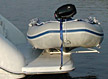 Pull on, roll on, slide on davits and davit systems for inflatable boats and dinghies.